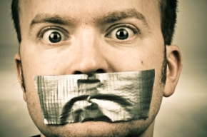 man-with-tape-over-mouth