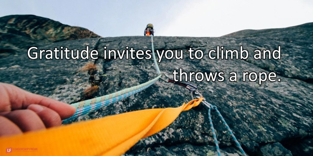 Rock Climbing.  Gratitude invites you to climb and throws a rope.
