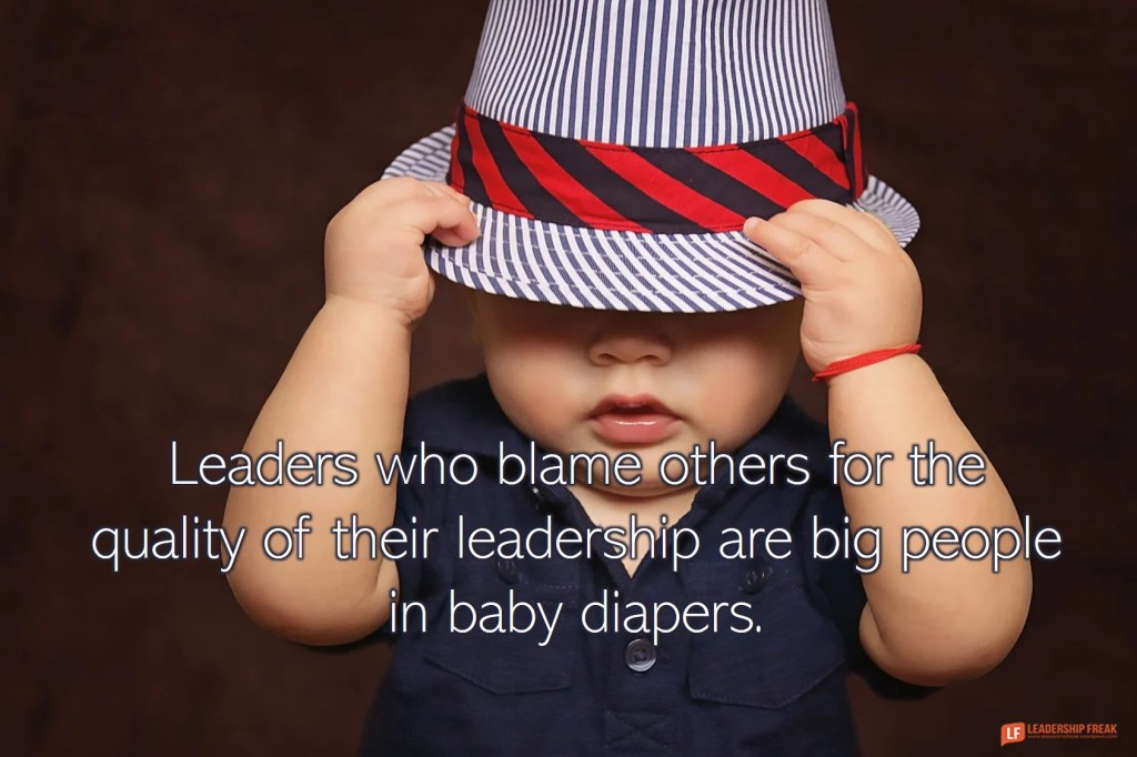 Toddler in hat.  Leaders who blame others for the quality of their leadership are big people in baby diapers.