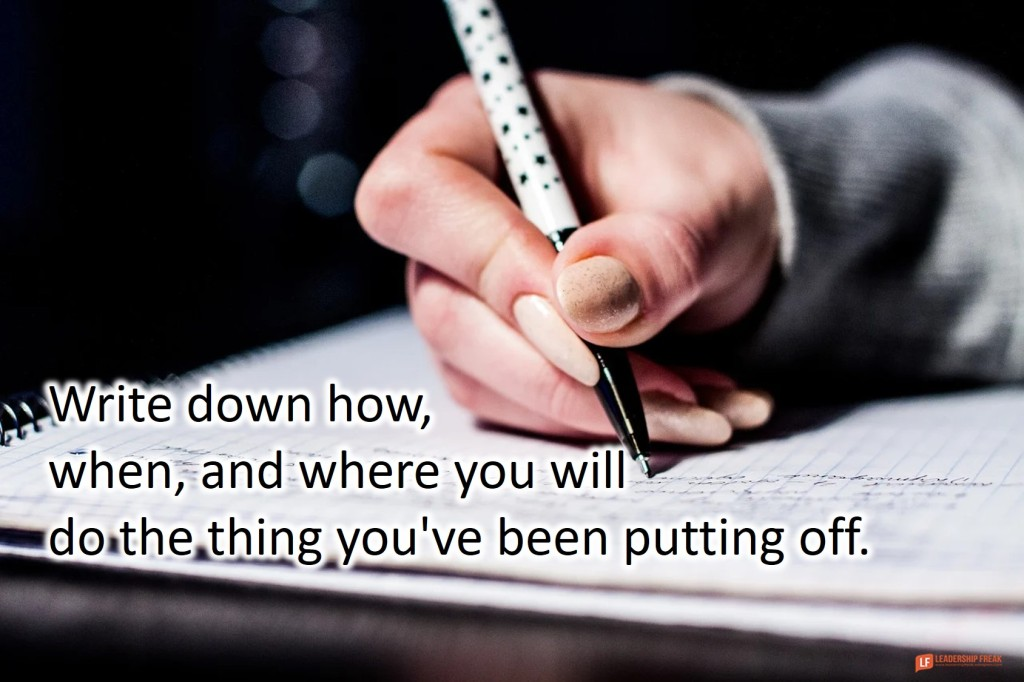 Notebook and pen.  Write down how, when, and where you will do the thing you've been putting off.