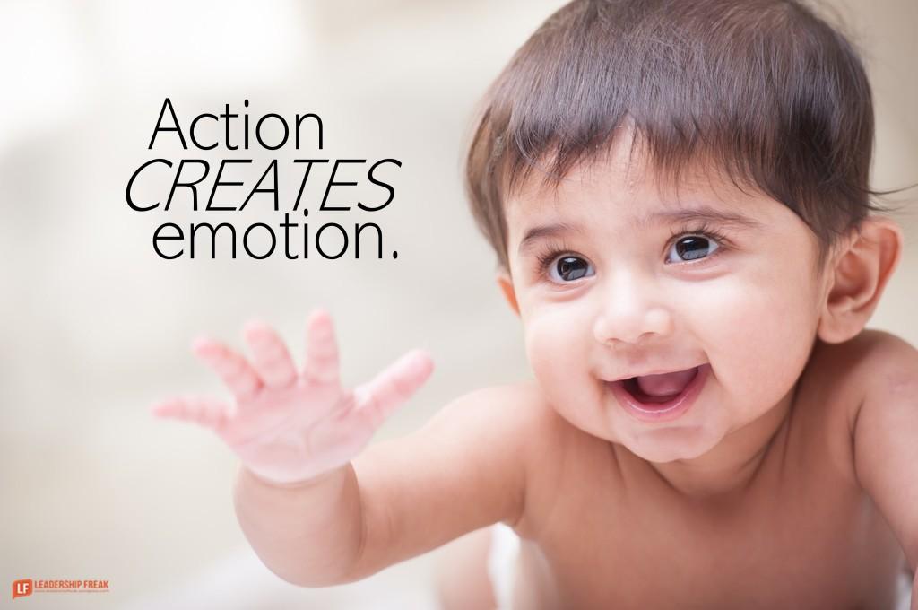 Baby smiling.  Action creates emotion.