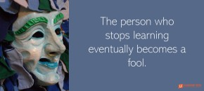 """Picture of a fool's mask with the quote, """"The person who stops learning eventually becomes a fool."""""""