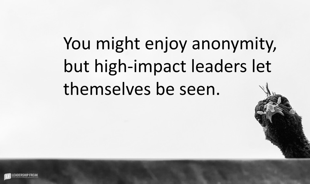 """Image of a peeking peacock. """"You might enjoy anonymity, but high-impact leaders let themselves be seen."""""""