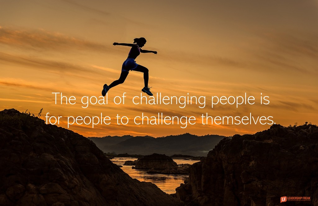 """Image of a woman jumping across a valley. """"The goal of challenging people is for people to challenge themselves."""""""