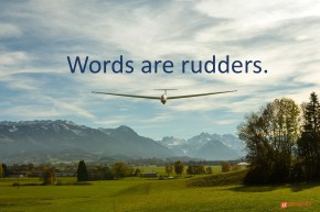 Image of a glider with mountains in the background.