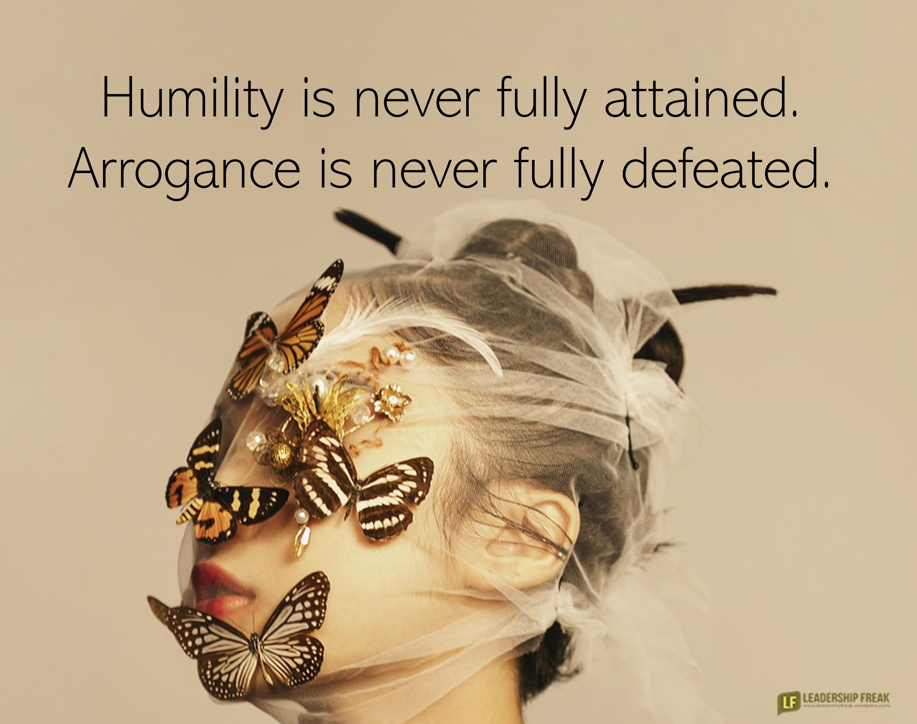 Woman in a veil with butterflies on her face.  Humility is never fully attainted. Arrogance is never fully defeated.
