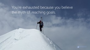Image of a mountain climber reaching the summit.